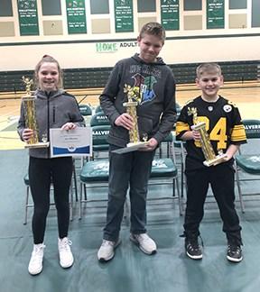 Three winners of the spelling bee.